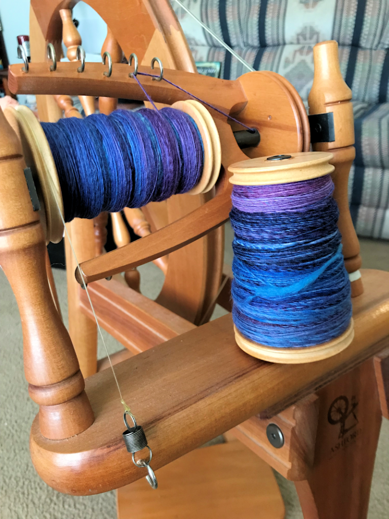 "Full and partially completed bobbins of Malabrigo Nube in the ""Whales Road"" colorway, handspun by Lark."
